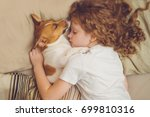 Stock photo sweet curly girl and jack russell dog is sleeping in night 699810316