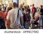 closeup queue of europen people ... | Shutterstock . vector #699817582