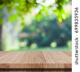 empty wooden table over blurred ... | Shutterstock . vector #699835936