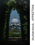 Small photo of The dome of Saint Peters Basilica seen through the famous keyhole at the the gate of the Priory of the Knights of Malta on Aventino Hill. Rome, Italy, Southern Europe
