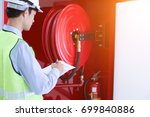 engineer inspection fire... | Shutterstock . vector #699840886