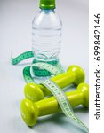 dumbbells and a bottle of water ... | Shutterstock . vector #699842146