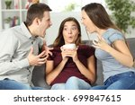 upset friend in the middle of a ... | Shutterstock . vector #699847615
