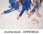 three pair of womens' legs on... | Shutterstock . vector #699848026