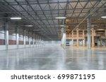 empty factory building or... | Shutterstock . vector #699871195