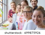 a portrait of six smiling ... | Shutterstock . vector #699875926