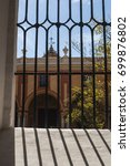 Small photo of Spain, 18/04/2016: details of the Patio del Crucero, a courtyard of the Alcazar of Seville, the royal palace example of mudejar architecture and Renaissance and Baroque decorations, seen from a grille