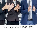 business people clapping hands... | Shutterstock . vector #699881176