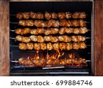 roasted chickens on spit... | Shutterstock . vector #699884746