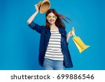 beautiful woman with glasses... | Shutterstock . vector #699886546