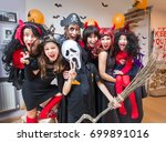 large family in costumes has... | Shutterstock . vector #699891016