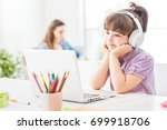 happy cute girl watching videos ... | Shutterstock . vector #699918706