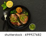 pork cutlet on a bone with... | Shutterstock . vector #699927682