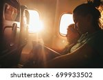 mother and son read a books... | Shutterstock . vector #699933502