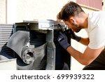 young man electrician installer ...   Shutterstock . vector #699939322