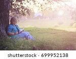 female in the park on sunset... | Shutterstock . vector #699952138