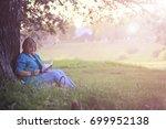 female in the park on sunset...   Shutterstock . vector #699952138