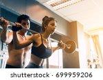 personal trainer helping women... | Shutterstock . vector #699959206