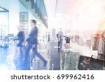 business people walking in a... | Shutterstock . vector #699962416