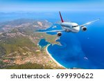 airplane is flying over amazing ... | Shutterstock . vector #699990622