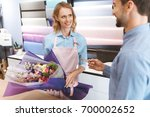 male client giving credit card... | Shutterstock . vector #700002652