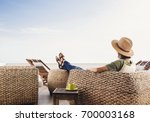 young woman resting on hotel... | Shutterstock . vector #700003168