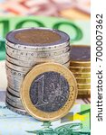 banknotes and euro coins | Shutterstock . vector #700007362