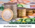 banknotes and euro coins   Shutterstock . vector #700007392