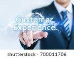 a businessman is touching a... | Shutterstock . vector #700011706