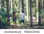 couple in pine forest | Shutterstock . vector #700015456