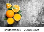fresh juice from ripe oranges . ... | Shutterstock . vector #700018825