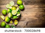 ripe limes in a bowl. on a... | Shutterstock . vector #700028698