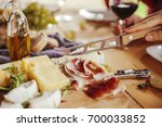 friends drinking wine and... | Shutterstock . vector #700033852