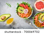 healthy salad bowl with salmon  ... | Shutterstock . vector #700069702