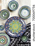 ethnic uzbek ceramic tableware. ... | Shutterstock . vector #700069756