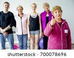 group of seniors doing exercises | Shutterstock . vector #700078696