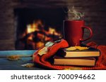 hot tea and book with autumn... | Shutterstock . vector #700094662
