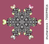 snowflake ornament on a pink... | Shutterstock .eps vector #700099816