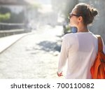 young cheerful woman with small ... | Shutterstock . vector #700110082