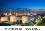 white oil tank and refinery... | Shutterstock . vector #700115872
