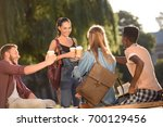 group of happy students... | Shutterstock . vector #700129456