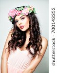 fashion brunette woman with... | Shutterstock . vector #700143352