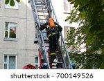 the fireman in the helmet... | Shutterstock . vector #700149526