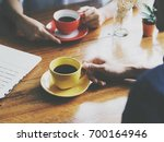 woman  hand holding cup of...   Shutterstock . vector #700164946