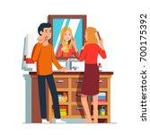 woman brushing hair standing in ... | Shutterstock .eps vector #700175392