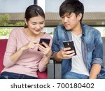 young adult asia man and woman... | Shutterstock . vector #700180402