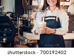 close up on coffee take away... | Shutterstock . vector #700192402