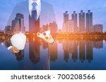 engineer holding white helmet...   Shutterstock . vector #700208566