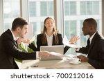 attractive businesswoman enjoys ... | Shutterstock . vector #700212016