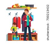 father getting dressed putting... | Shutterstock .eps vector #700213432